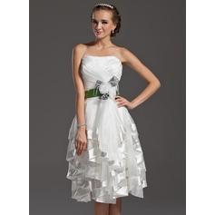 A-Line/Princess Sweetheart Knee-Length Organza Homecoming Dress With Sash Feather Flower(s) Bow(s) Cascading Ruffles